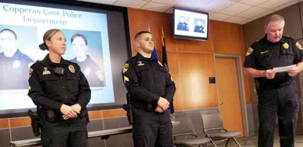 Copperas Cove Chief of Police Tim Molnes lists off the ccomplishments of Sergeant Gabriel Cardona, center and Corporal Christina Shappard during a promotion ceremony Wednesday afternoon.