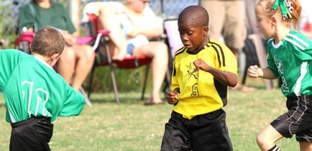 Ninjas' Darrius Gray splits a pair of Minecraft Creepers defenders during their 9-under match up. Gray had one goal and one assist in the Ninjas' 2-1 win over the Creepers on Saturday at Copperas Cove City Park.