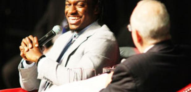 Robert Griffin III, former Copperas Cove standout, Heisman Trophy winner and current Washington Redskins quarterback, laughs as he talks with Baylor president Ken Starr during An Evening with Robert Griffin III, presented by the Gerald Bolfing Family, benefiting the Friends for Life organization, on Friday at Baylor's Ferrell Center in Waco.