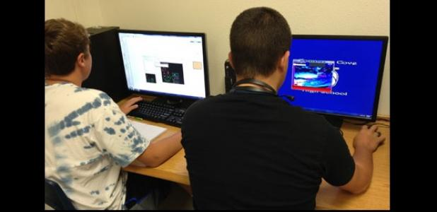 Joshua Bishop and Francisco Quinones work on games they are creating as students in Copperas Cove High School's Advanced Video Game Design III class.