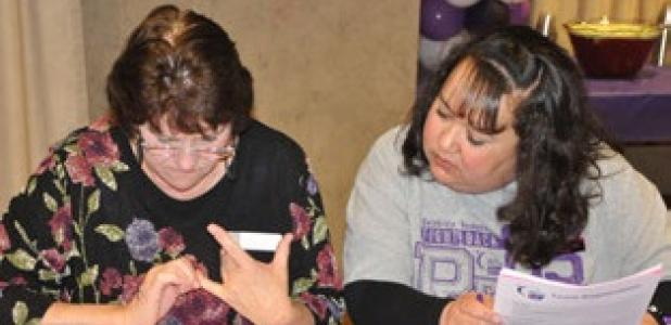 Cancer survivor, Lindy Sudduth and Co-Chair Rose Fleming participate in Thursdays Relay for Life Bingo.