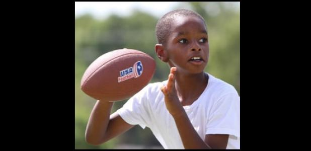 Eight-year-old Malik Davis competes in the NFL Punt, Pass and Kick competition Saturday at Copperas Cove City Park. Davis won the 8-to-9 yearold boys division.