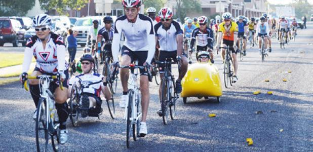Cyclists head west on FM 1113 Saturday morning as they take off for the annual Cove House Classic.