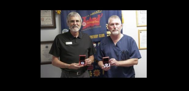 Gary Kafer, left and J.D. Sheffield hold their Morning Exchange Club of Copperas Cove coins following Sheffield's presentation regarding his recent visit to the Mexico/Texas border.