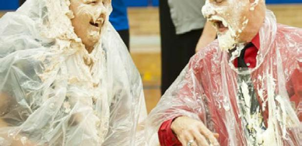 Copperas Cove Junior High sixth grade teacher Jennifer Wills is smashed in the face with a chocolate pie after she and fellow teacher Gene Turner collected the most funds for the annual United Way campaign on the campus.