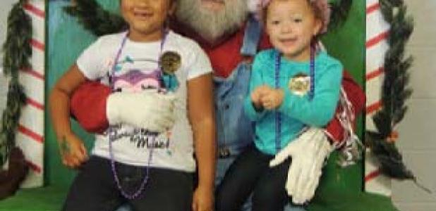 Santa poses for photos with children during the annual Christmas on the Farm celebration in Belton.