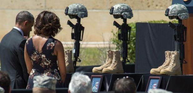 United States President Barack Obama and Mrs. Michelle Obama pay their respects to the fallen Soldiers after a memorial ceremony at Fort Hood Wednesday.