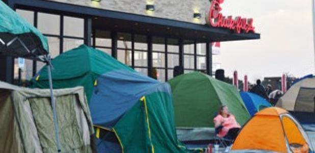 A tent city popped up overnight as patrons of Chick-Fil-A vied for a spot to be apart of the first 100 during the grand opening promotion receiving a free meal a week for a year.