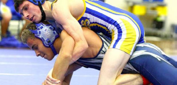 Copperas Cove's Lane Teeter takes the back of Shoemaker's Angel Rodriguez during their 113-pound matchup on Monday at Copperas Cove High School. Shoemaker edged out Cove with a 7-5 match win total. Ariel Lewis, Cory Smith, Lane Robinson and Adam Smalley also notched wins.
