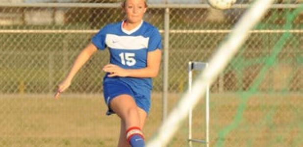 Copperas Cove senior Shelbie Letzer boots the ball in from the corner during the win over Ellison Tuesday night.