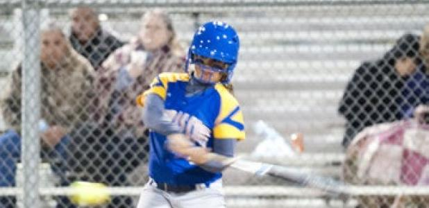 Carlee Duran turns on a pitch for a single during the Lady Dawgs' victory over Shoemaker.