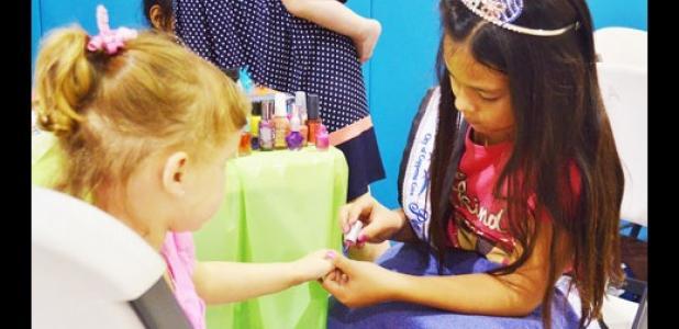 Natalie Perez, Preteen Miss Rabbit Fest, paints fingernails at the Pretty Princess Parlor at Saturday's YMCA back to school party.