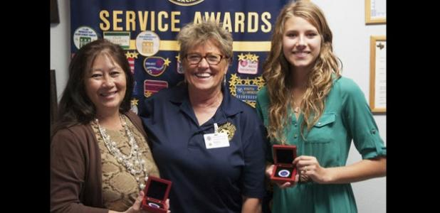 Chamber of Commerce President Betty Price,left, updated the Morning Exchange Club on state of the Chamber at the request of Marty Smith,center. Rabbit Fest royalty Kelsey Dane shared her platform of volunteer service with the club.