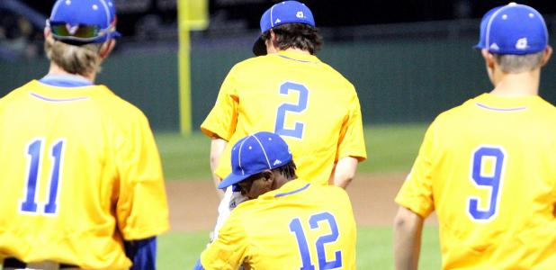 Copperas Cove lefty ace Jaylen Smith (12) picks up righty ace Cameron Johnson as Colby Jost (11) and Cam Petet (9) look on after Johnson's no-hitter in a 2-0 shutout of Ellison Tuesday at Bulldawg Field. Johnson struck out 12 of the 26 batters faced in 6 2/3 innings on the bump.