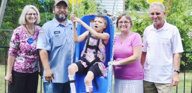 Mona Lopez enjoys her new play area from the Make-A-Wish Foundation. Left to Right: Cindy Daly, Gabriel Lopez, Mona, Mira Lopez, Bill Daly.