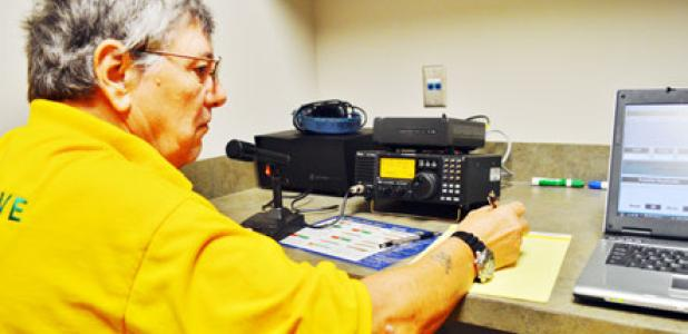 Ted Bruski, a Copperas Cove ham radio operator, writes down a call sign from another operator in Florida at Saturday's Amateur Radio Relay League field day.