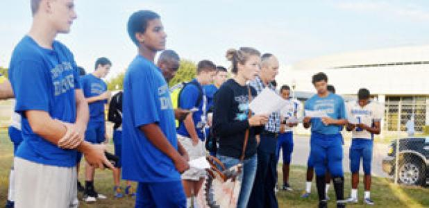 Students from Copperas Cove High School worship during the annual See you at the Pole Wednesday.