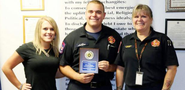 Dylan Karl, center, was honored as the firefighter of the quarter by the morning exchange club. Presenting him for the award is Captain Carla Polidoro and his fiancee Jamie McCartney.