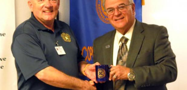 Mark Peterson, left, presents Marc Nigliazzo President of Texas A&M University Central Texas with an Exchange Club mug following his presentation Wednesday morning.