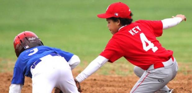 Justin Best of the Royals 12U baseball team stumbles in to second base in front of the tag attempt of Cardinals shortstop Josiah Key during their Copperas Cove Parks and Recreation league game Tuesday at Copperas Cove City Park.