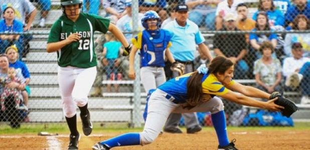 Autumn Hughes stretches for a putout at first as Ellison Lady Eagle Sydney Clemente sprints down the first base line. Copperas Cove allowed one run in the blowout.