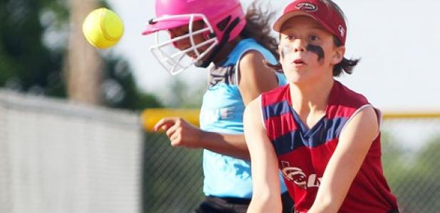 10U Diamondbacks third baseman Brooklyn Thompson waits on the throw as Marlins' Jayna Carrero safely reaches base during their Copperas Cove Parks and Recreation league game Wednesday at city park.