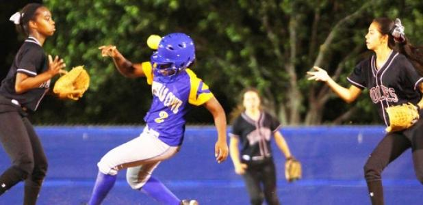 Copperas Cove junior Zhianna Johnson (2) beats out the flip from Timberview's Nala Stokes to Alex Taylor during Game 1 of their best-of-three series on Friday at the Waco ISD Softball Complex. Timberview won thes eries 2-0.