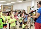 CCLP/DAVID J. HARDIN - Children's singer/songwriter Joe McDermott performs for local children at the Copperas Cove Public Library on Thursday as part of the library's summer reading program.