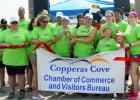 CCLP/LYNETTE SOWELL - Juile Moser and Jen Reynolds cut the ribbon for Pink Warrior Angels on Saturday.