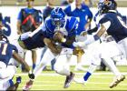 CCLP/STEVEN DOLL - Copperas Cove senior quarterback Caine Garner gets trapped between Sachse defenders Micah Buchanan, Isaiah Humphries and Cedric Johnson during the second quarter of Friday evening's game at Homer B Johnson Stadium in Garland.