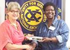 Courtesy Photo - Noon Exchange Club of Copperas Cove President Inez Faison presents Brenda Titus a gift for her presentation about Hope Pregnancy Center during the September 16 meeting.