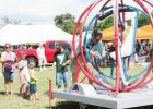 CCLP/BRITTANY FHOLER - One of the attractions at the 3rd Annual Holy Family Fall Fest was the Spaceball Gyroscope.