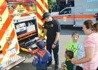 CCLP/LYNETTE SOWELL - Jaxon and C.J. Phillips, along with their mother, Haley, check out a fire truck after a 9-11 remembrance ceremony held in their neighborhood on Sunday afternoon. The gathering was attended by neighbors along with Copperas Cove first responders.