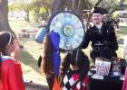 Sisters Secret, Diamond, and Gabby Diaz spin the Cinergy Cinema wheel for a prize at the Trick or Treat aisle at the Copperas Cove Fall-O-Ween Festival on Saturday at City Park.
