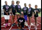 CCLP File Photo - The Centex Pacesetters pose with their medals during practice at Salado Junior High. The qualifying athletes are, left-to-right, Reginald Mouton, Brianna Washington, Zoe Pearson, Michaela Mouton, Katelyn Mouton, Abigail Mouton, Jaylen Watson (kneeling) and Amber Boyd (not pictured).