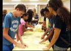 CCLP/PAMELA GRANT - Teenagers play with their own bits of dough at the dough show put on by Domino's at the library. The dough show was the library's reward to the teens at the end of the Summer Reading Program.