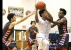 CCLP/TJ MAXWELL - Cove sophomore Quinton Ford splits a pair of San Angelo Central defenders in the Bulldawgs' 72- 62 win on Tuesday. The Dawgs (17-10, 5-3) play Ellison tonight in Killeen.