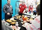 CCLP/LYNETTE SOWELL - Eric Smith, an H-E-B bakery partner, talks to military spouses about the artisan breads and other products available at the store's bakery. H-E-B Plus! and the USO hosted spouses at an event on Wednesday which featured tips for shopping on a budget.