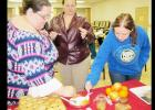 CCLP/ PAMELA GRANT - Participants in Taura Pool's medieval marmalade class try samples of Pool's quince, peach, and apple marmalades.
