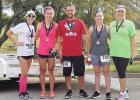 CCLP/PAMELA GRANT - Julie Moser and Jen Reynolds award medals to the 1st, 2nd, and 3rd place winners of the Pink Warrior Angels' 2nd Annual Pink Warrior Dash 5k run/walk. Alex Wilson came in 1st, Christian Riedenaur came in 2nd, and Chellie Cannon came in 3rd.