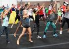 CCLP/BRITTANY FHOLER - Kids and mascots learn the choreography to the official dance at the National Dance Day held at GymKix Saturday afternoon.