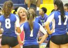 CCLP/TJ MAXWELL - Copperas Cove head volleyball coach Cari Lowery talks to her team during a time out early in the season. The Lady Dawgs have three more game remaining before district action begins against Killeen on Friday, Sept. 9 at home.