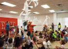 CCLP/PAMELA GRANT - Taylor Griswold, owner of Epic Entertainment, and Kazoo fired toilet paper into the audience as part of their show at the library's Summer Reading Program.