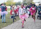 CCLP/FILE PHOTO - Pink Warrior Angels is holding its one-year celebration on Saturday along with a ribbon cutting as it joins the Copperas Cove Chamber of Commerce. Among the events it has held in the last year was the Pink Warrior Dash 5K, which drew approximately 100 runners and walkers to South Park.