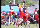 CCLP/TJ MAXWELL - Cove junior receiver Floyd Connell makes a catch between two Ellison defenders in their consolation bracket showdown during the 2016 Texas 7on7 Championships at Veteran's Park in College Station. The Dawgs were 2-3 in the tournament.