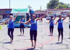 CCLP/LYNETTE SOWELL - The Royal Blue Twirlers of Copperas Cove High School performed during Waffle Cone's sixth birthday celebration in Cove Terrace Shopping Center.