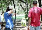 CCLP/KATHLEEN STARLING - Participants in PAR Guns archery class Saturday take aim with survival bows at archery block targets.