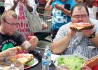 CCLP/CHUCK TAYLOR - Contestants prepare to eat as much as they can of a three-pound burger at H-E-B's burger-eating contest on Saturday afternoon.
