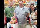 CCLP/CHUCK TAYLOR - Darren Blair of Copperas Cove emerged victorious among the four customers competing in the burger-eating contest on Saturday at Copperas Cove H-E-B Plus!.