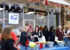 CCLP/LYNETTE SOWELL - Shoppers gather outside Candy Outfitters for the annual kickoff party sponsored by the Chamber of Commerce.
